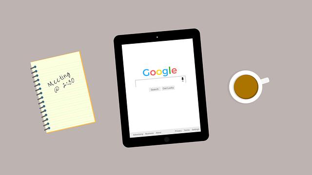ノートとタブレットとコーヒー